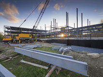 Building construction site. Construction site for commercial building at sunset Stock Photo