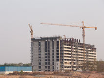 Building construction site with Crane Stock Images