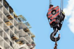 Building construction site - crane hook against blue sky Royalty Free Stock Images