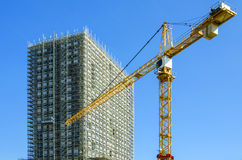 Building construction site with crane Stock Photos