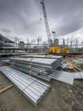 Building construction site with crane. And steel flooring in foreground Stock Photos