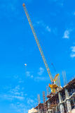 Building construction site with crane tower machinery Stock Photo
