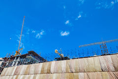 Building construction site with crane tower machinery Royalty Free Stock Photo