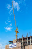 Building construction site with crane tower machinery royalty free stock image