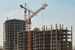 Building construction site with cranes under sky Royalty Free Stock Photos