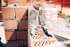 Building construction site. Details of exterior brick walls and cement Royalty Free Stock Photography