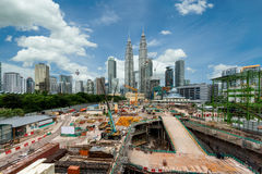 Building construction site with Kuala lumpur city skyscraper Stock Photos