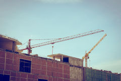 Building construction site with large construction crane Royalty Free Stock Images