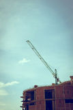 Building construction site with large construction crane Royalty Free Stock Image