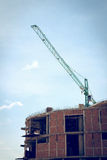 Building construction site with large construction crane Royalty Free Stock Photo