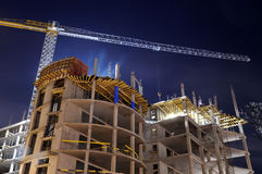 Building construction site at night Stock Images