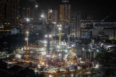 Building construction site at night. Ground breaking construction of apartment with lots of crane stock photos