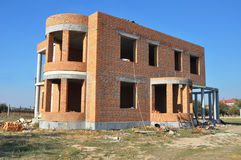 Building & Construction Site in Progress to New Red Brick House Exterior. Construction Brick House Work Outdoor Royalty Free Stock Photo