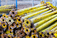 Building construction site stack support pipes Royalty Free Stock Photography