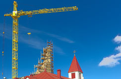 Building Construction Site Using High Crane. HDR Toning Image Royalty Free Stock Photography