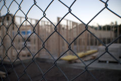 Building construction site through wire fence Royalty Free Stock Photos