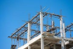 Building construction. Site work against blue sky Stock Photos
