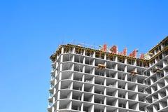 Construction site work. Building construction site work against blue sky Stock Image