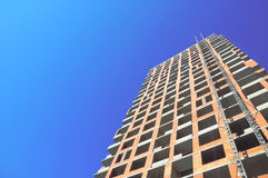 Building construction site work against blues sky. Royalty Free Stock Photo