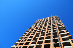 Building construction site work against blues sky. Rear view. Royalty Free Stock Photo