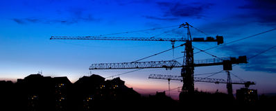 Building construction at sunset