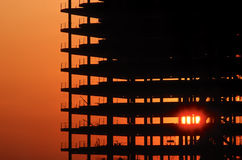 Building construction at sunset. Building under construction at sunset with sun flare Stock Photo