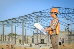Building construction supervisor Viewing construction plan