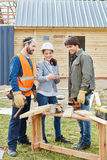 Building construction team with architect and craftsmen Royalty Free Stock Photo