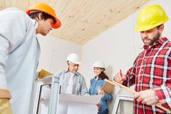 Building construction team working on floorplan Stock Image