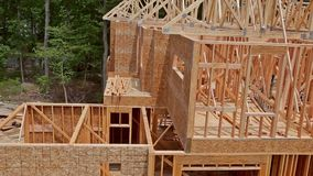 Building construction, wood framing structure at new property development site. Building construction, wood framing and beam construction structure at new stock footage