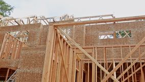 Building construction, wood framing structure at new property development site. Building construction, wood framing and beam construction structure at new stock video footage