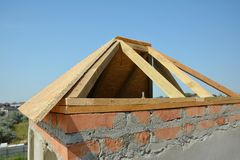 Building construction wooden panel roof on unfhinished house brick chimney installation stock photos