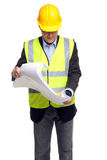 Building contractor in safety gear with plans Stock Photos