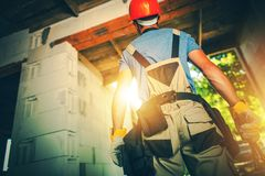 Building Contractor at Work. Caucasian Construction Site Worker with Tools stock photography