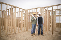 Building Contractors on Construction sitWide Angle Royalty Free Stock Photo