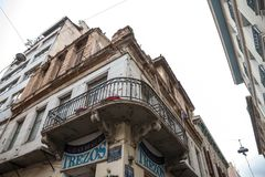 Building corner in Psyri district of Athens city center, left to decay and ruin, with a balcony on foreground. Picture of the crossing between Palados and Stock Image