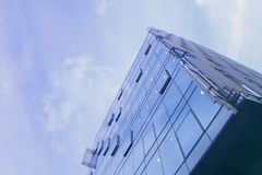 Building a corporate office business low angle. Glass and steel Art Nouveau business district skyscraper. Technological commercial. Photo royalty free stock image