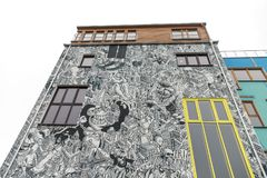 Building Covered with Cartoon in Berlin, Germany. Building Covered with Cartoon in Berlin City, Germany Royalty Free Stock Image