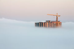 Building covered by fog Stock Photography