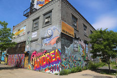 Building covered with murals and graffiti in Williamsburg section in Brooklyn Stock Photos