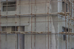 Building covered with scaffolding at construction site Stock Photos