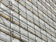 Building covered in white tarpaulin. Royalty Free Stock Photo