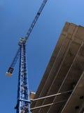 Building crane. Over blue sky Stock Photos