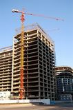 Building crane. Construction of a new building, a colorful crane Royalty Free Stock Image