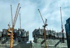 Building Crane And Buildings Under Construction And Cloudy Sky,Bangkok Thailand Stock Images