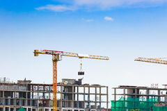 Free Building Crane And Construction Site Under Blue Sky Royalty Free Stock Photography - 58733667