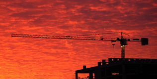 Building crane on background the red sky Royalty Free Stock Photography