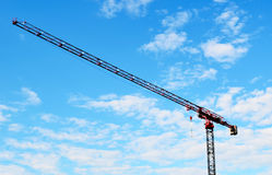 Building crane and blue sky Stock Image