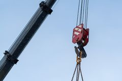 Hook of a construction crane against a blue sky royalty free stock image