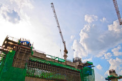 Building crane and building under construction. Royalty Free Stock Photography